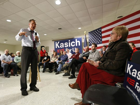 SETTING THE BAR: Republican presidential candidate John Kasich, the governor of Ohio, answers a question about Planned Parenthood Wednesday, Dec. 16, 2015, during a town hall meeting in Ankeny, Iowa.