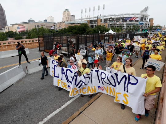 Demonstrators make their way over the Lorain-Carnegie bridge into downtown during a protest Thursday in Cleveland, during the final day of the Republican National Convention.