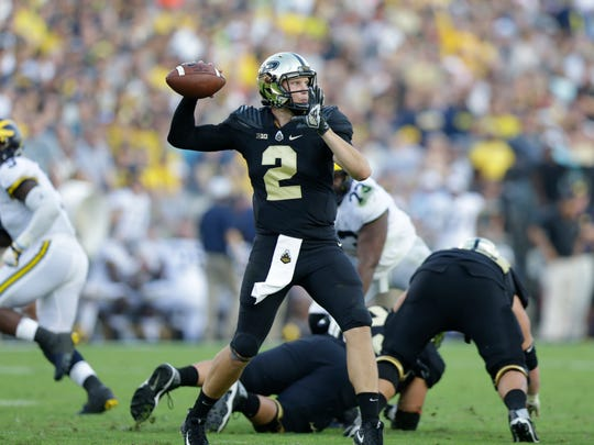 Purdue quarterback Elijah Sindelar (2) throws against Michigan during the second half of an NCAA college football game in West Lafayette, Ind., Saturday, Sept. 23, 2017. Michigan defeated Purdue. (AP Photo/Michael Conroy)