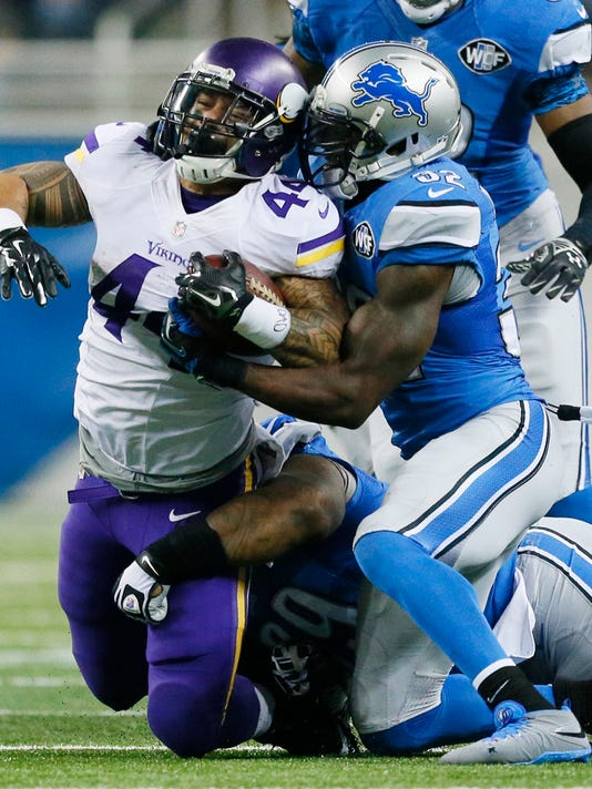 Minnesota Vikings running back Matt Asiata (44) is tackled by Detroit Lions strong safety James Ihedigbo (32) during the first half of an NFL football game at Ford Field in Detroit, Sunday, Dec. 14, 2014. (AP Photo/Rick Osentoski)