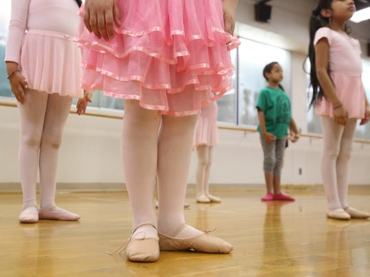 Elementary students learn ballet in an after-school