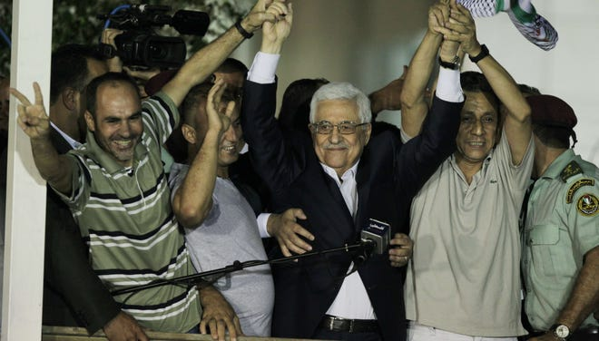 Palestinian President Mahmoud Abbas delivers a speech to released Palestinian prisoners at his headquarters in the West Bank city of Ramallah  on Aug. 21.