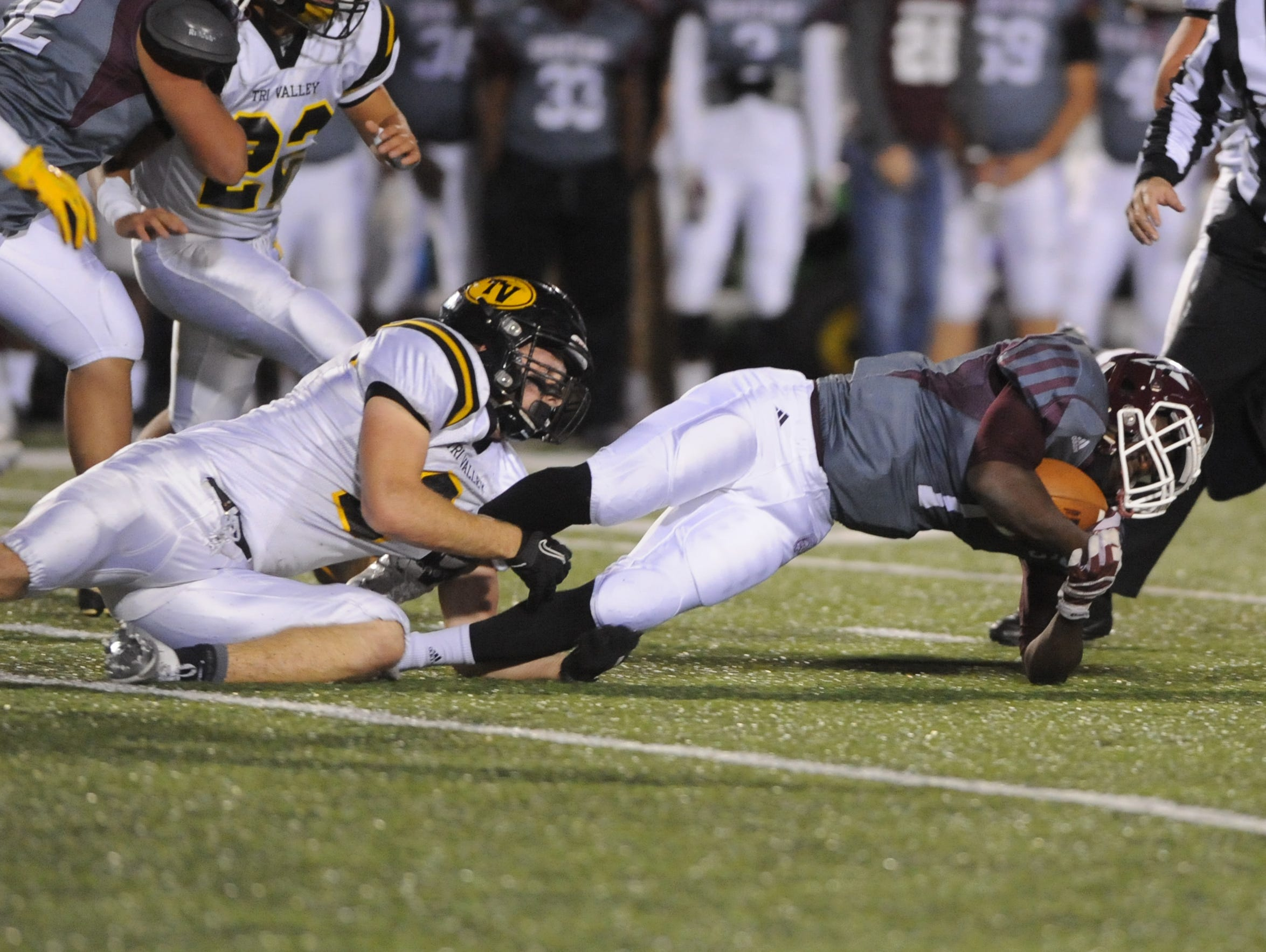 Tri-Valley's Grant Nolder brings down Youngstown Boardman's Koby Adu-Poku during the Scotties 27-2 victory over the Spartans on Friday during their Division II quarterfinals playoff game. Nolder, a senior, was named third-team All-Ohio on Monday.