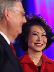 U.S. Sen. Mitch McConnell acknowledges his wife Elaine Chao while addressing supporters at a victory celebration at the Marriott East hotel in eastern Jefferson County. McConnell handily won his sixth senate term. Nov. 4, 2014.