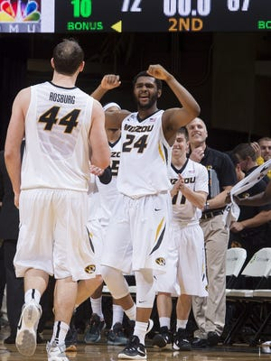 Missouri's Kevin Puryear (24) celebrates with teammate Ryan Rosburg, left, after they defeated South Carolina 72-67 in an NCAA college basketball game, Tuesday, Feb. 16, 2016, in Columbia, Mo. (AP Photo/L.G. Patterson)