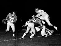 New York Giants defensive back Dick Lynch (22), who has just intercepted an Atlanta Falcons pass, keeps a wary eye on Falcons defender Chuck Sieminski as he leap over blockers Wendell Harris (26) and Larry Vargo (25). The Giants defeated the Falcons 14-7 before a crowd of 20,945 fans at Dudley Field Aug. 13, 1966 for the pre-season game.