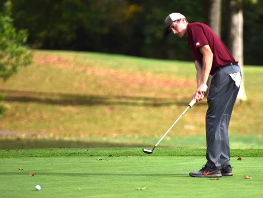 Stuarts Draft's Ryan Thompson putts on the 9th green