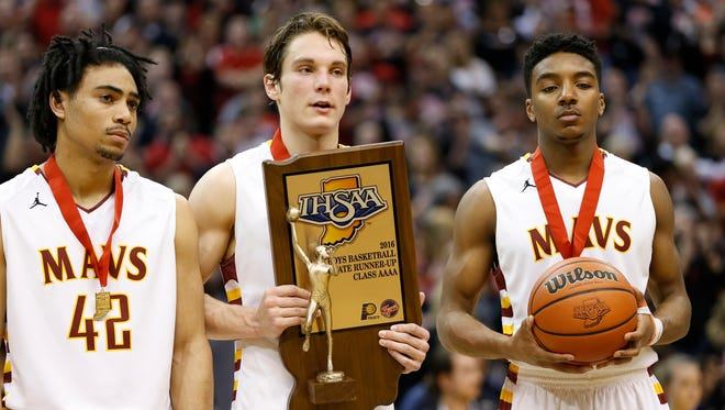Billy Loft, from left, Haden Deaton and Charles Phinisee can't hide their disappointment after falling to New Albany 62-59 in the Class 4A state championship Saturday at Bankers Life Fieldhouse in Indianapolis. Phinisee was named the recipient of the mental attitude award.