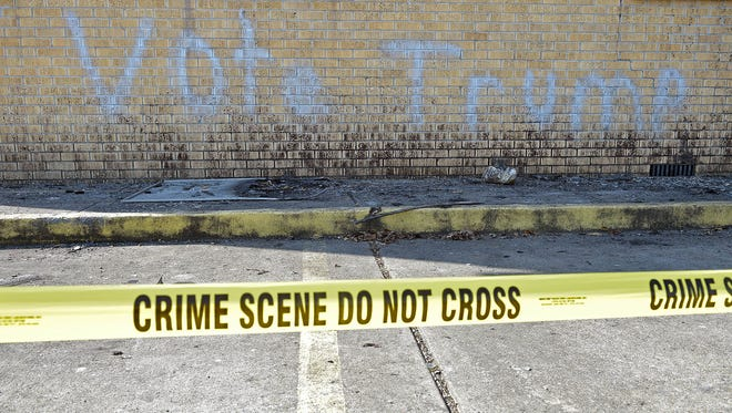 Police tape surrounds the burned and vandalized Hopewell Missionary Baptist Church in Greenville, Miss., on  Thursday, Nov. 3, 2016.