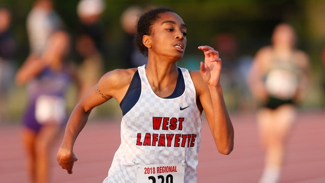Lauren Thomas of West Lafayette on her way to victory in the 400 meter dash with a new regional meet record time of 56.21 during the Girls Track and Field Regional Tuesday, May 22, 2018, at Lafayette Jeff. Thomas advances to state with her performance.