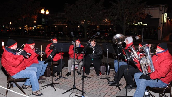 Holiday music filled Kellogg Park and the streets of downtown Plymouth as a Salvation Army brass band performed Friday evening during the Main Street boulevard tree lighting ceremony. The event also kicked off the Salvation Army Plymouth Corps' Red Kettle fundraising campaign.