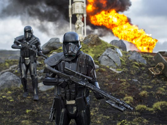 """Rogue One"" introduces a host of new characters, including Imperial Death Troopers who lay waste to a moisture farm in this scene."