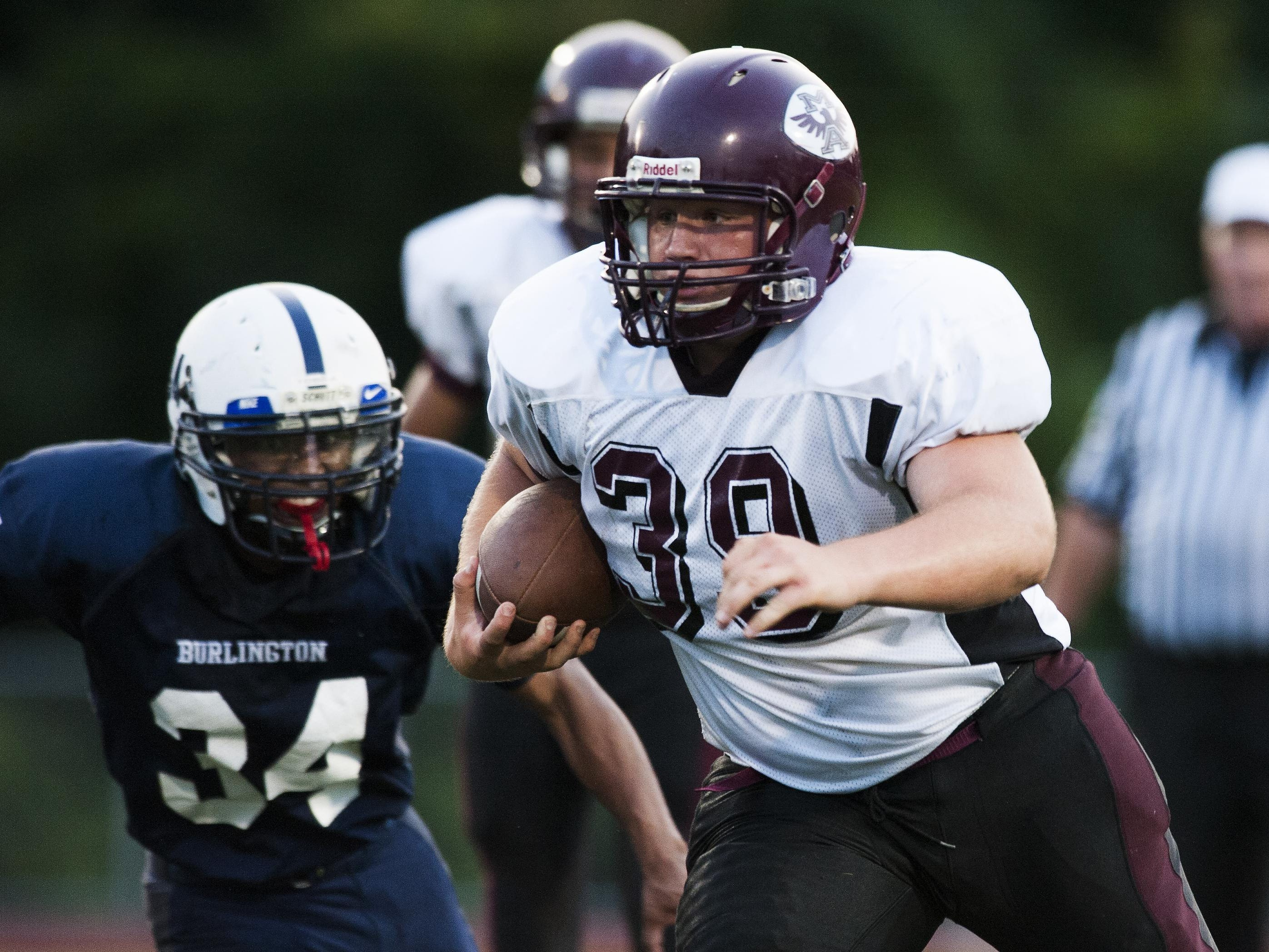 Mount Abraham's Casey Kimball (39) runs with the ball during Friday night's football game against Burlington at Buck Hard Field. Kimball led the Eagles with 85 yards rushing on 11 carries.