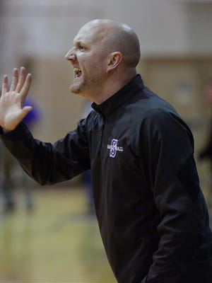 Southwood head coach Norm Picou yells form the bench during his game against Byrd.