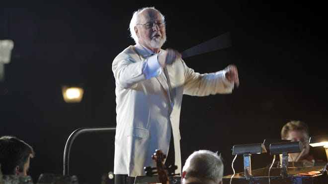 Composer and conductor John Williams leads the Orlando Philharmonic Orchestra during the grand opening celebration at the Wizarding World of Harry Potter at Universal Orlando Resort theme park in Orlando on June 16, 2010.