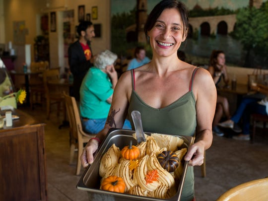Co-owner Silvia Bertolazzi holds a tray of her Speciale