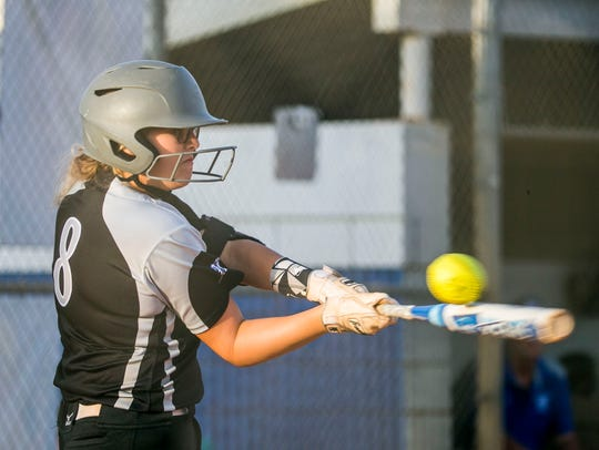 Mariner player Alexis Baker bats during the Class 6A