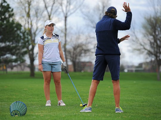 Augustana's Emily Israelson talks with coach Peggy Kirby on the driving range before playing a round of golf Thursday, April 21, 2016, at Kuehn Golf Course in Sioux Falls.