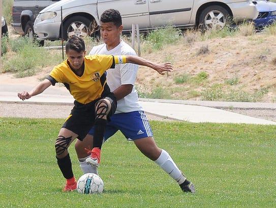 Alamogordo senior Keith Wilder tries to get around