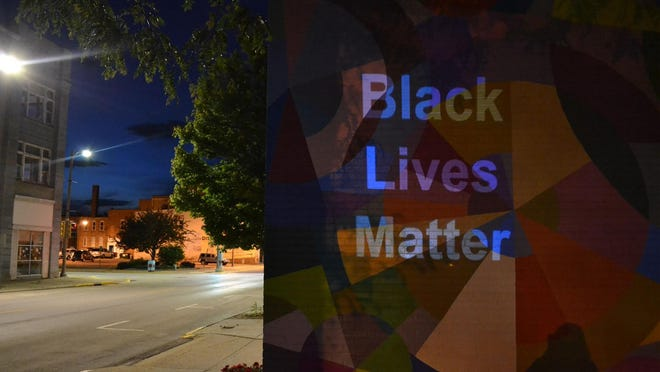 """The phrase """"Black Lives Matter"""" was projected onto the wall of the Box Gallery on East Simmons Street in Galesburg from 8 to 11 p.m. Sunday night."""