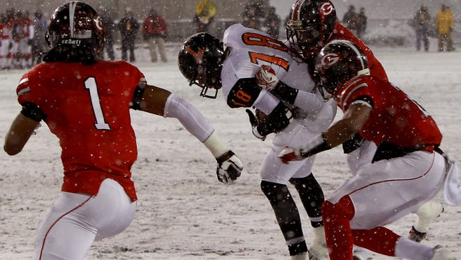Loveland tight end Jake Elfers (18) caught a touchdown pass against Cleveland Glenville safety Erick Smith (1), cornerback Marshon Latimore (2) and cornerback Aaron Ivory (3) in the second quarter of Loveland?s Division II state championship win in December. Joseph Fuqua II/Community Press OHLoveland1207 Sports Friday December 6, 2013: Loveland TE Jake Elfers (18) caught a touchdown pass against Cleveland Glenville S Erick Smith (1), CB Marshon Latimore (2), CB Aaron Ivory (3) in the second quarter. Loveland High School battles Cleveland Glenville High School in Division II state Championship football game at Fawcett Stadium Friday December 7, 2013 in Canton, Ohio.