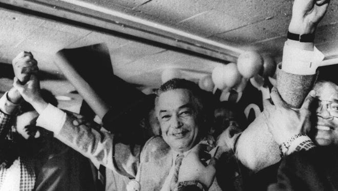 Coleman A. Young gives the victory sign after learning that he has been elected as mayor of Detroit on Nov. 7, 1973.