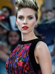 """Scarlett Johansson, shown at the London premiere of her new movie """"Avengers: Age of Ultron,"""" hosts """"Saturday Night Live"""" this week."""