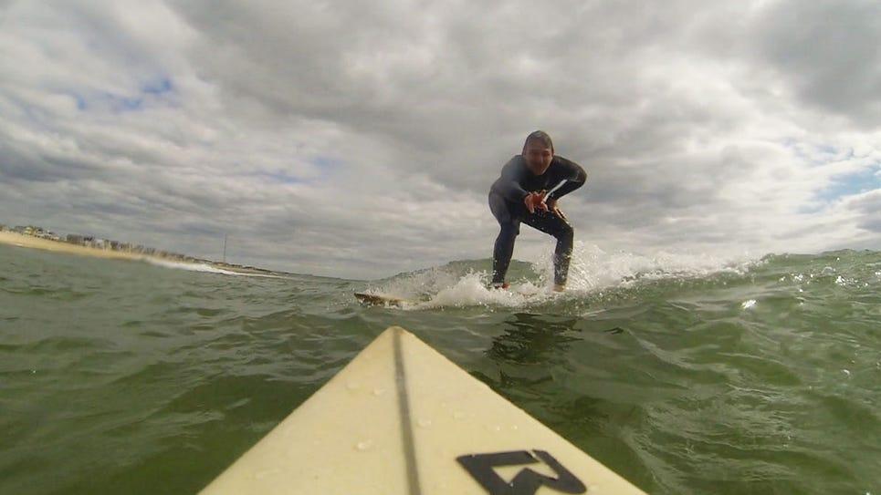 Asbury Park Press staff writer Dan Radel rides a wave