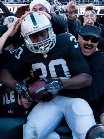 Oakland Raiders running back Jalen Edwards (30) leaps