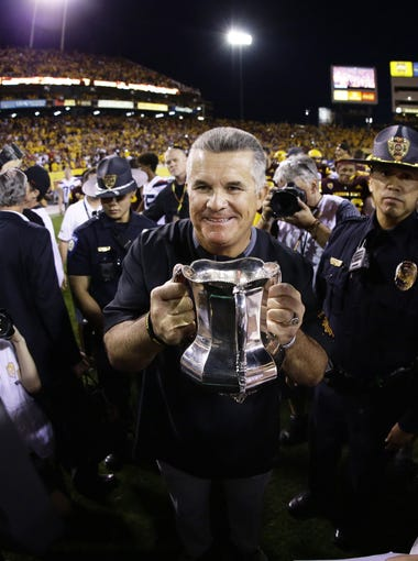 Arizona State head coach Todd Graham takes back the Territorial Cup from Arizona on Nov. 25, 2017 during the 91st Annual Territorial Cup in Tempe, Ariz.