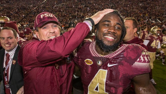 In this Nov. 26, 2016 photo, Florida State coach Jimbo Fisher and running back Dalvin Cook celebrate a 31-13 win over Florida in Tallahassee, Fla.