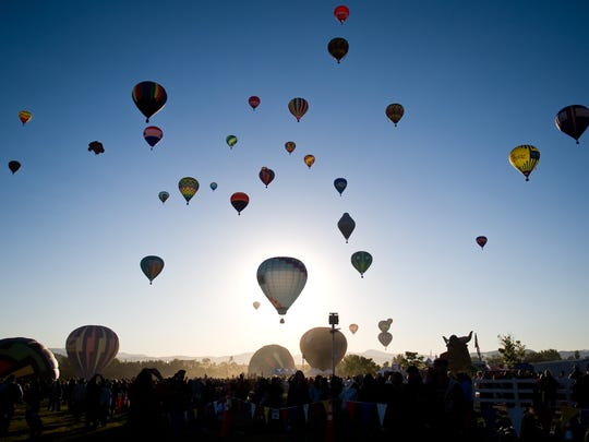 Hot air balloons take over the Reno skyline during mass ascension at the Great Reno Balloon Race.