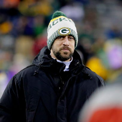 Green Bay Packers quarterback Aaron Rodgers watches