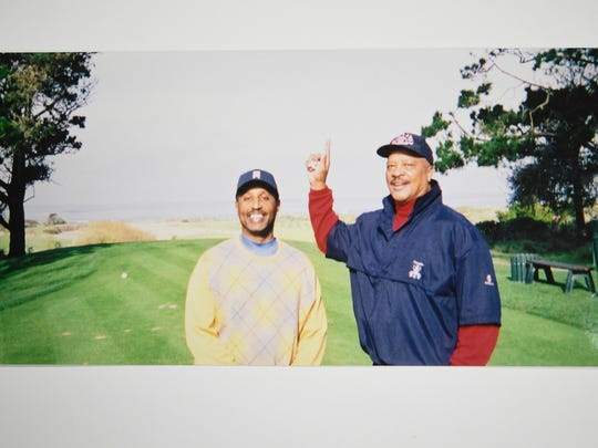 Dwayne Tucker, left, with his cousin and mentor Frank Pillow at Pebble Beach golf course in the late 1990s.
