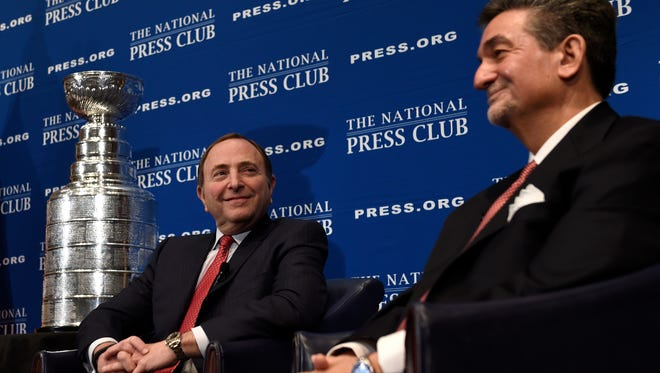 NHL Commissioner Gary Bettman, left, sits next to Monumental Sports Chief Executive Officer Ted Leonsis, right, as they talk about the growth of the NHL and the 2015 Winter Classic game at the National Press Club Newsmaker Luncheon in Washington.