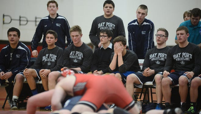 Bay Port's bench stares as Wisconsin Rapids Lincoln scores in the 285-pound match during a WIAA Team Sectional at Pulaski High School in Pulaski, Wis. on Tuesday, Feb. 17, 2015.