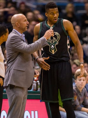 Bucks head coach Jason Kidd talks with forward Giannis Antetokounmpo during a recent game.