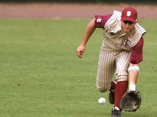 -  -5-15-01,1C-  -SPECIAL TO THE PENSACOLA NEWS-JOURNAL, AUTH. EDITOR: GORDON PAULUS-FSU center fielder Karl Jernigan, from Milton, scoops up a Hurricane single during the Miami game Sunday.