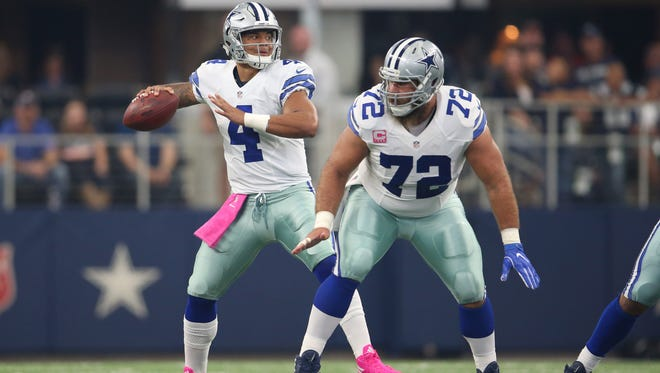 Cowboys center Travis Frederick protects quarterback Dak Prescott during a game against the Bengals at AT&T Stadium.