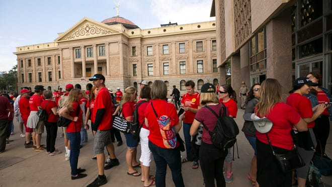 Teachers and other supporters wait in line to enter the state house during the fifth day of the Arizona teacher walkout at the state Capitol in Phoenix on May 2, 2018.