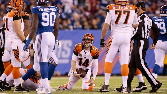 Cincinnati Bengals quarterback Andy Dalton (14) gets back to his feet after being sacked on Monday night.