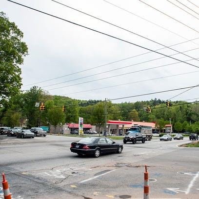 Traffic moves slowly through the intersection of Mills Gap and Sweeten Creek roads during rush hour Thursday. Gov. Pat McCrory has proposed a $1.4 billon bond issue for the state's highway needs, but large Buncombe County projects like a planned widening of Sweeten Creek Road would not be directly impacted.