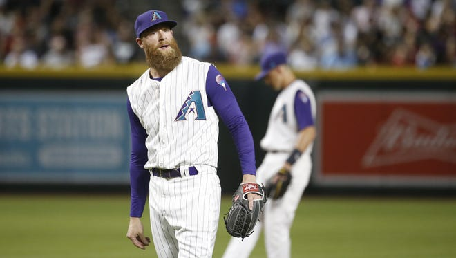 Diamondbacks Archie Bradley (25) reacts after balking in a run against the Nationals in the eighth inning at Chase Field in Phoenix, Ariz. on May 10, 2018.