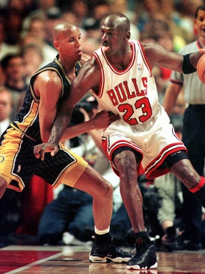 Reggie Miller plays defense against Michael Jordan in Game 1 of the 1998 Eastern Conference Finals.
