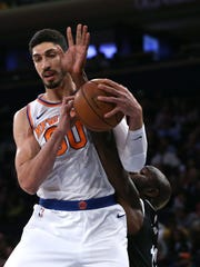 Knicks center Enes Kanter grabs a rebound against Brooklyn