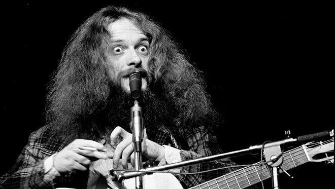 """Ian Anderson, leader of Jethro Tull, makes one of his many bizarre facial expressions as he talks with his fans as the group performs """"Thick as a Brick"""" before nearly 9,000 delirious fans Oct. 24, 1972, in the Municipal Auditorium."""