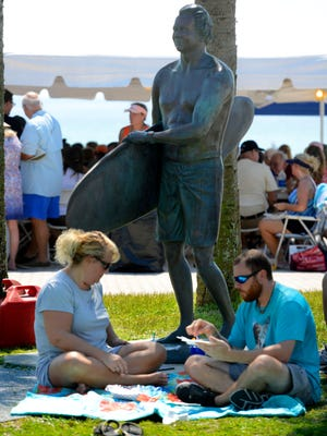 Natalie Goss and Shane Foran sample food Saturday during Taste of the Beach at Pensacola Beach. Along with seventeen Pensacola Beach restaurants offering servings of some of there signature dishes, there was music, cooking demonstrations and cook-offs.