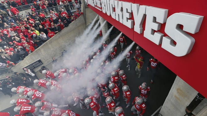 File photo - Ohio State Buckeyes players take the field prior to the NCAA football game against the Michigan State Spartans at Ohio Stadium in Columbus on Nov. 11, 2017.