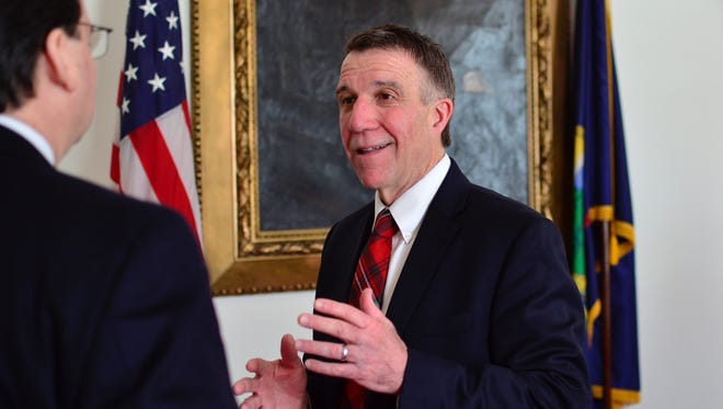 Vermont Gov. Phil Scott speaks to a reporter following a news conference Friday, Feb. 17, 2017.