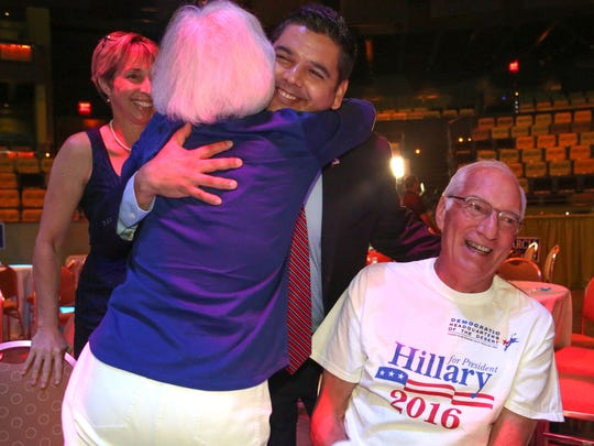Rep. Raul Ruiz gets a hug from supporter Ro Inspruker as Don Zigler, right, looks on at the Democratic watching party in Rancho Mirage, November 8, 2016.